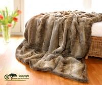 kuscheldecken kaufen aus fellimitat merinowolle oder kaschmir. Black Bedroom Furniture Sets. Home Design Ideas