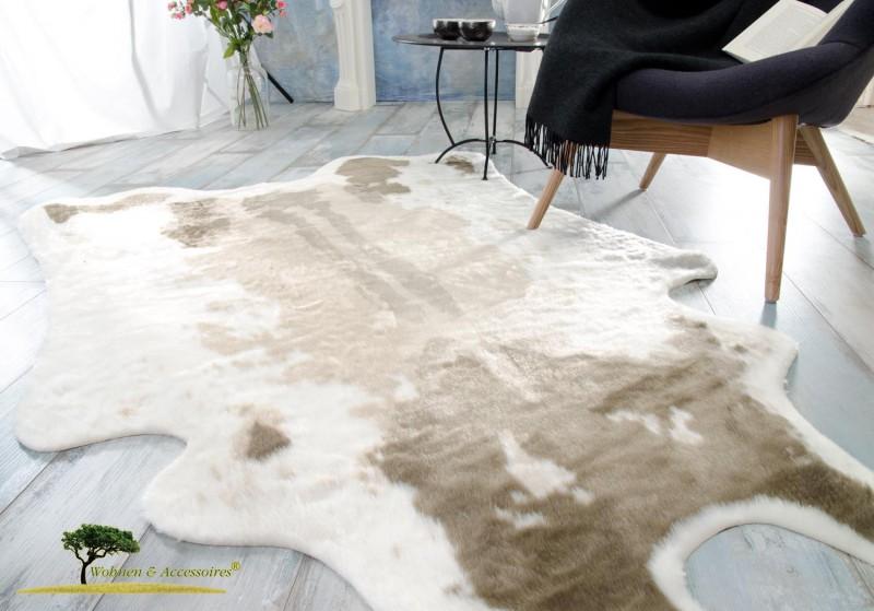 kuhfell teppich kaufen hellbraun aus kunstfell zum top preis wolldecken shop. Black Bedroom Furniture Sets. Home Design Ideas